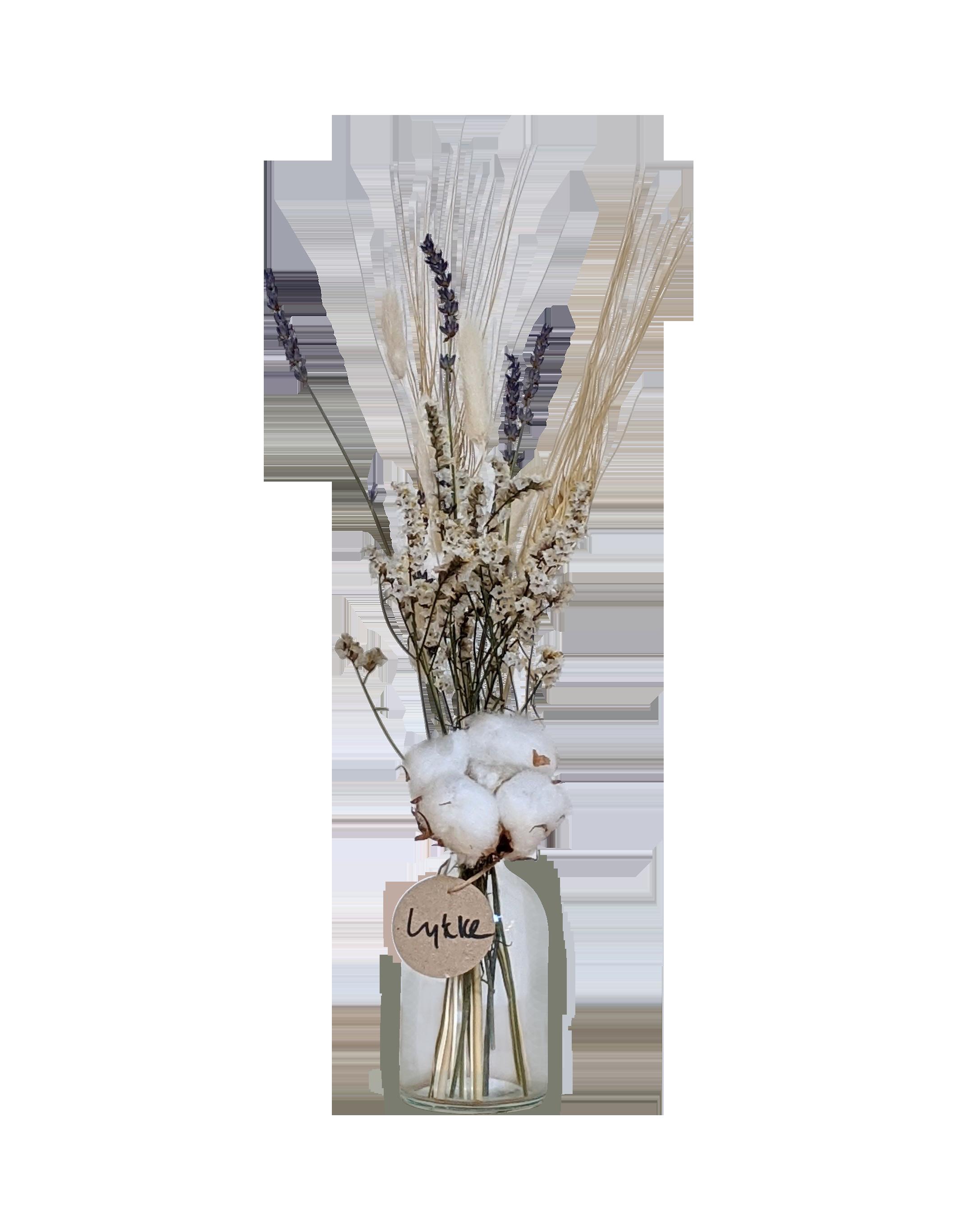 בקבוקון שקוף של פרחים מיובשים עם כותנה לבנדר חיטה לימוניום יבשים